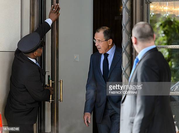 A concierge blocks the door as Russian Foreign Minister Sergei Lavrov leaves the Intercontinental Hotel on the third day of talks on Iran's nuclear...