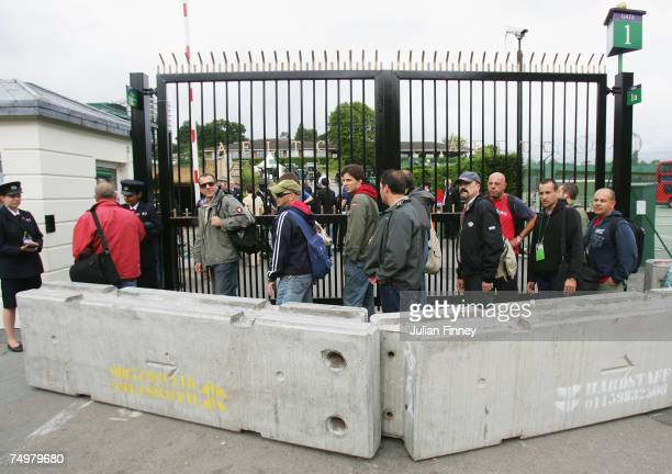 Concrete blocks are added as an extra security measure prior to day seven of the Wimbledon Lawn Tennis Championships at the All England Lawn Tennis...