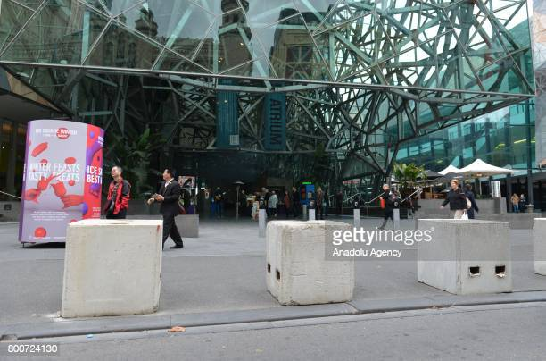 Concrete blocks are installed to prevent the possible vehicle attacks near pedestrian areas in Melbourne Australia on June 25 2017 Counterterror...