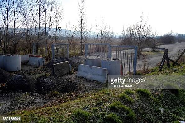 Concrete blocks are pictured at the site of the former chemical factory AZF in Toulouse southern France on January 20 2017 Who is responsible for the...