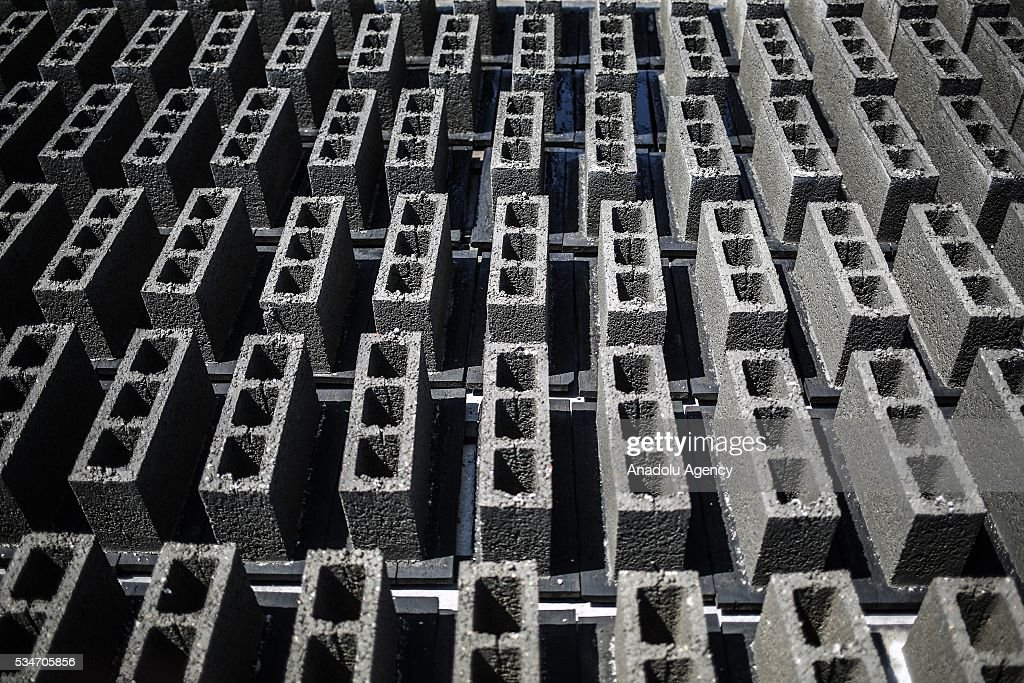 Concrete bricks are seen at the factory, restarting to manufacture after Israel allowed building materials' passing from Karim Abu Salim border gate in Gaza City, Gaza on May 25, 2016.