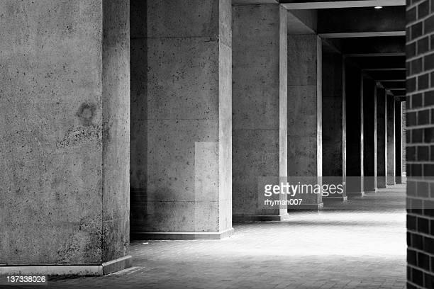 Concrete Column Corridor in Black and White