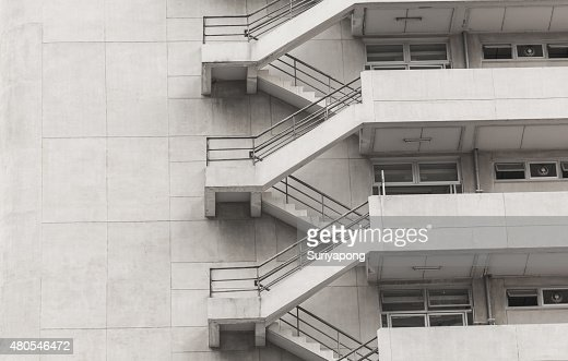 Concrete fire escape outside apartment building for emergency : Stock Photo