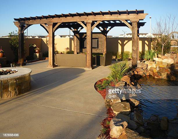 Concrete floors on an outdoor patio with koi pond and pagoda