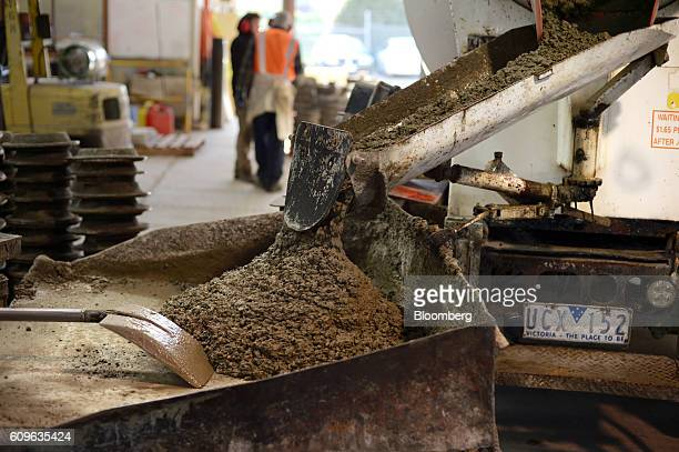 A concrete mixer unloads freshly mixed concrete onto a table at the warehouse of Gully Concrete supplies in Melbourne Australia on Tuesday Aug 16...