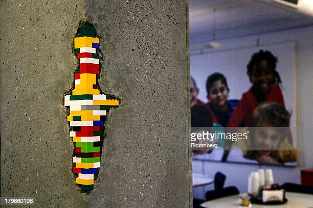 A concrete pillar features a 'repair' with multicolored toy bricks in the canteen area at the headquarters of Lego A/S in Billund Denmark on Thursday...