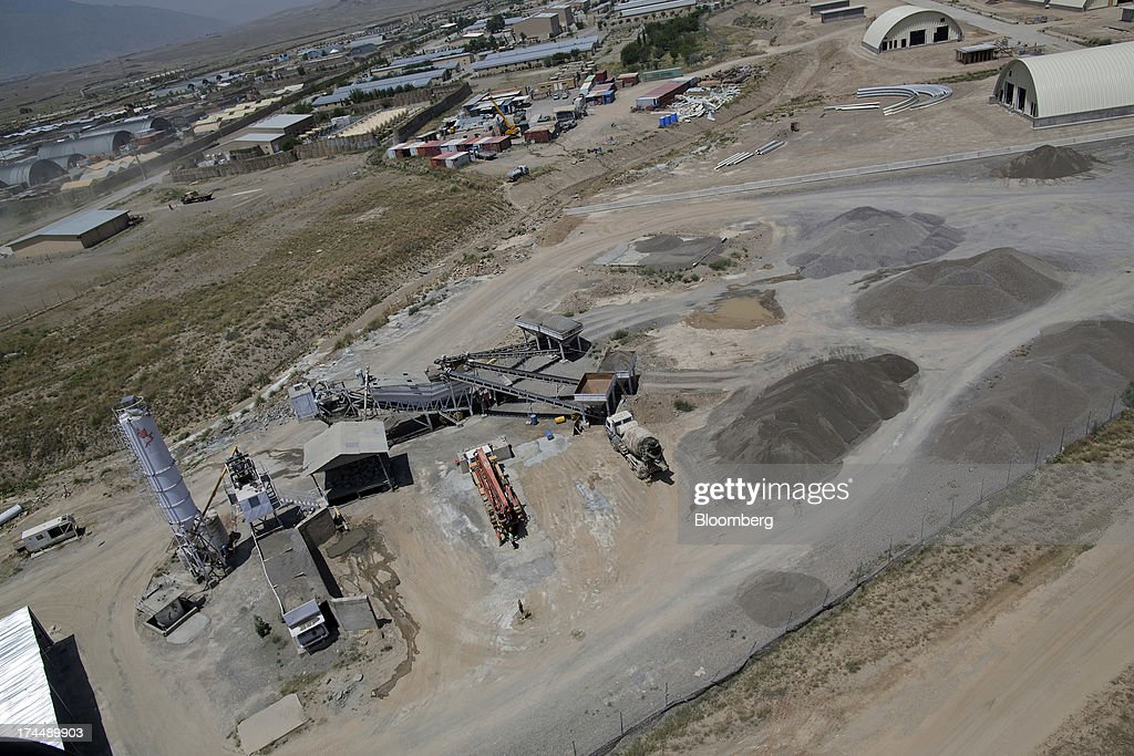 A concrete plant churns out supplies for construction at Camp Parsa, an Afghan Army base in Khost province, Afghanistan, on Saturday, June 22, 2013. U.S. President Barack Obama has maintained his position of ending U.S. combat in Afghanistan by the end of next year, though that plan has included keeping in place several thousand troops for support. Photographer: Victor J. Blue/Bloomberg via Getty Images