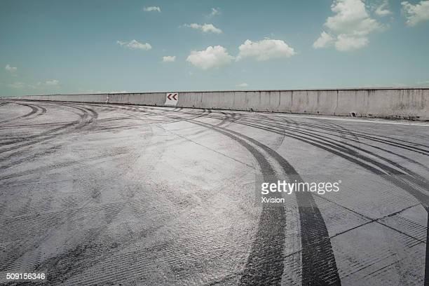 concrete platform with tire imprint trail