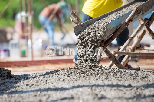 Concrete pouring during commercial concreting floors of building : Stock Photo