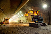 Concrete Road Tunnel Construction Excavator and Articulated Dump Truck