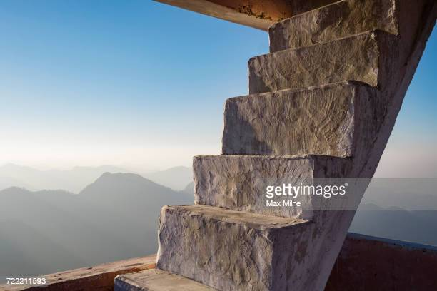 Concrete staircase overlooking scenic view of mountains