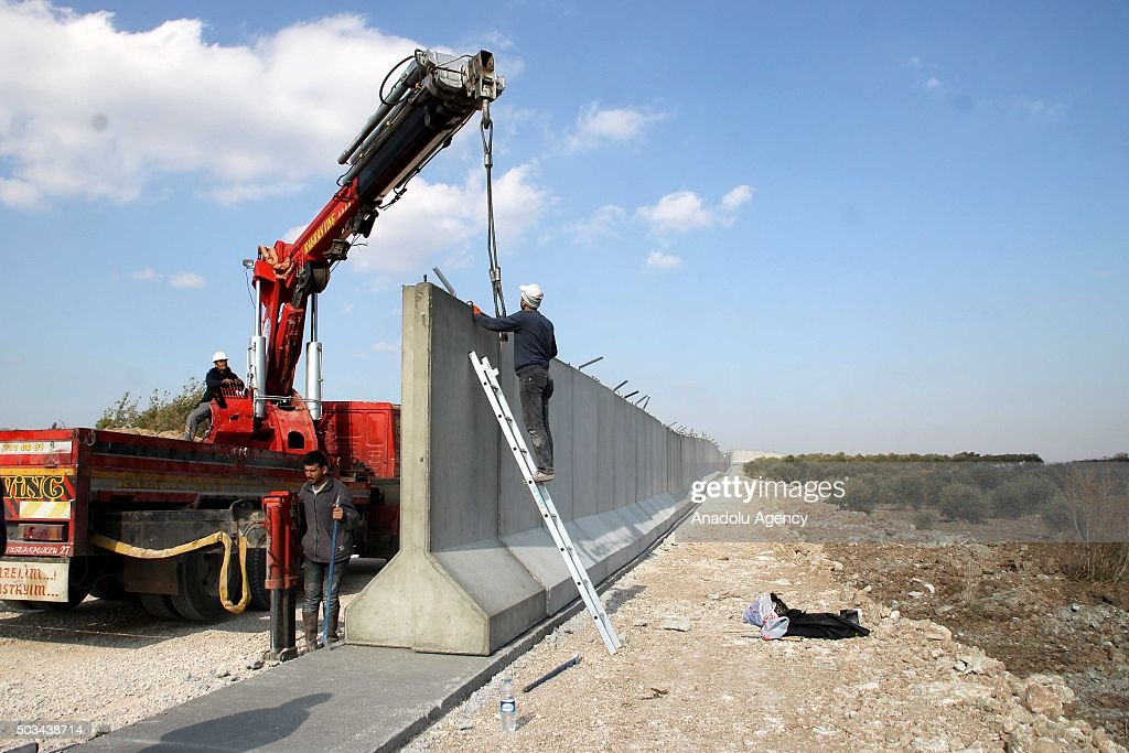 Concrete wall is built along the Turkey Syria border in