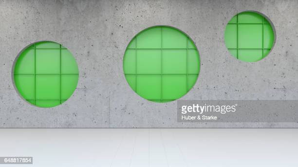 concrete wall with green metallic structure