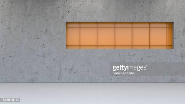 concrete wall with orange metallic structure