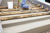 Concrete Worker Troweling New Steps