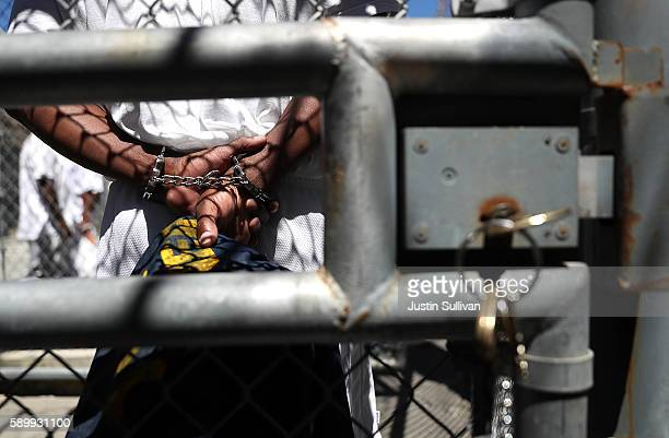 A condemned inmate stands with handcuffs on as he preapres to be released from the exercise yard back to his cell at San Quentin State Prison's death...