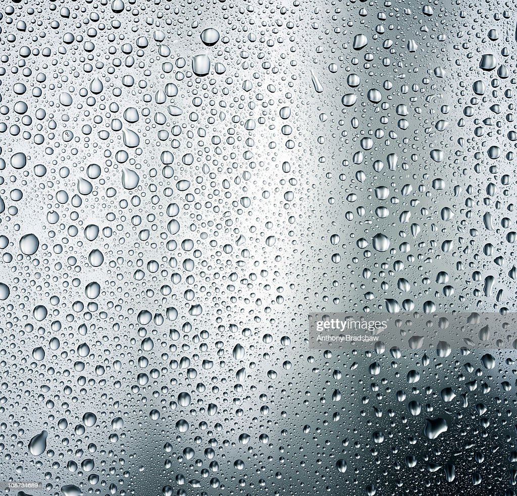 Condensation droplets on a grey background : Stock Photo