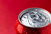 Macro view of water condensation over red aluminium can with copy space