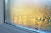Windowsill and glass covered in condensation water droplets