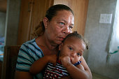 Condita Duplessis sits with granddaughter Kimora Barthelemy in their FEMA trailer May 14 2009 in Port Sulphur Louisiana Seven children and four...