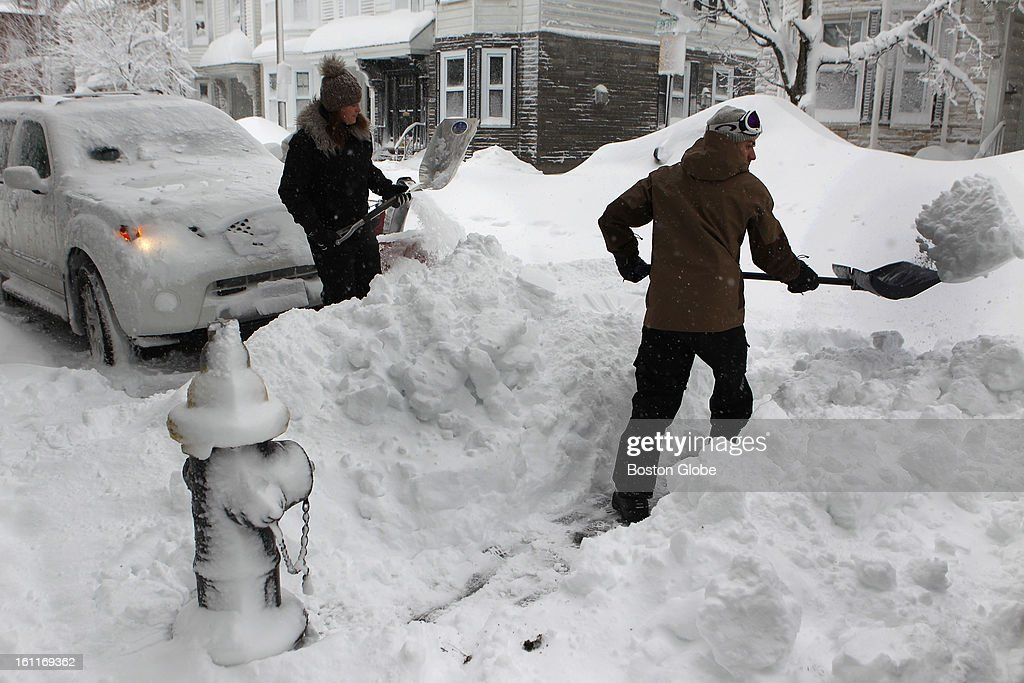 Ross Patterson, on right, digging out.