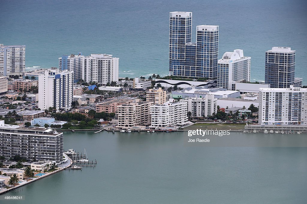 Condo buildings in Miami Beach are seen June 3, 2014 in Miami, Florida. According to numerous scientists, south Florida could be flooded by the end of the century as global warming continues to melt the Arctic ice, in turn causing oceans to rise. U.S. President Barack Obama and the Environmental Protection Agency yesterday announced a rule that would reduce the nation's biggest source of pollution, carbon emissions from power plants, 30% by 2030 compared to 2005 levels. It is widely believed that these emissions are a main cause of global warming.
