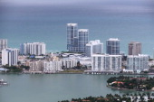 Condo buildings on ocean front propety in the city of Miami Beach are seen June 3 2014 in Miami Florida According to numerous scientists south...