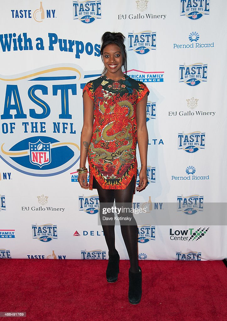 Condola Rashad arrives at the Taste Of The NFL 'Party With A Purpose' at Brooklyn Cruise Terminal on February 1, 2014 in New York City.