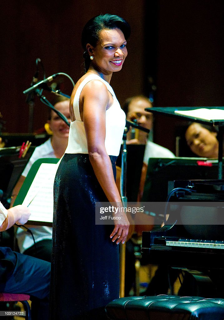 <a gi-track='captionPersonalityLinkClicked' href=/galleries/search?phrase=Condoleezza+Rice&family=editorial&specificpeople=157540 ng-click='$event.stopPropagation()'>Condoleezza Rice</a> performs with the Philadelphia Orchestra at the Mann Center for Performing Arts on July 27, 2010 in Philadelphia, Pennsylvania.