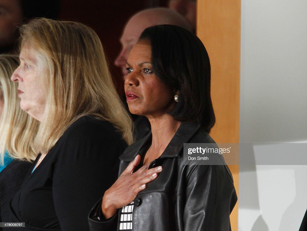 Condoleezza Rice stands for the national anthem before a NHL game between the San Jose Sharks and the Toronto Maple Leafs on March 11, 2014 at SAP Center in San Jose, California.