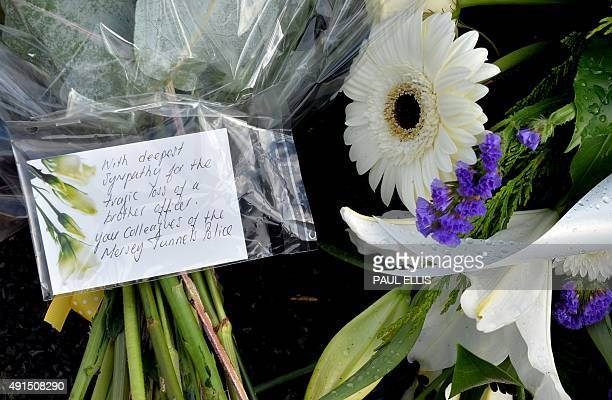 Condolence messages are attached to flowers near to the scene in Wallasey northwest England on October 6 2015 where Merseyside Police officer David...