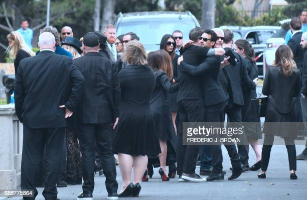 Condolences and hugs are offered following a service at the funeral for Soundgarden frontman Chris Cornell on May 26 2017 at the Hollywood Forever...