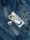 Condom on jeans, close up