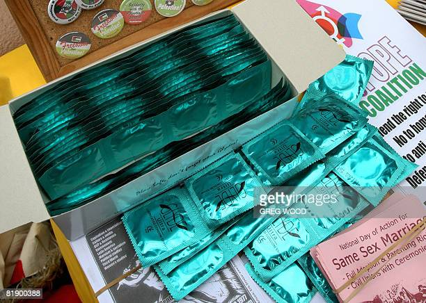 Condom packets are displayed at a NoToPope coalition 'annoying' fashion show held outside the New South Wales state parliament on July 9 2008 to...