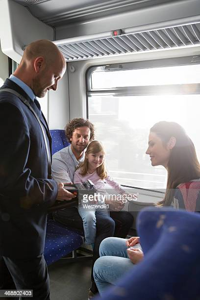Conductor and family in a train