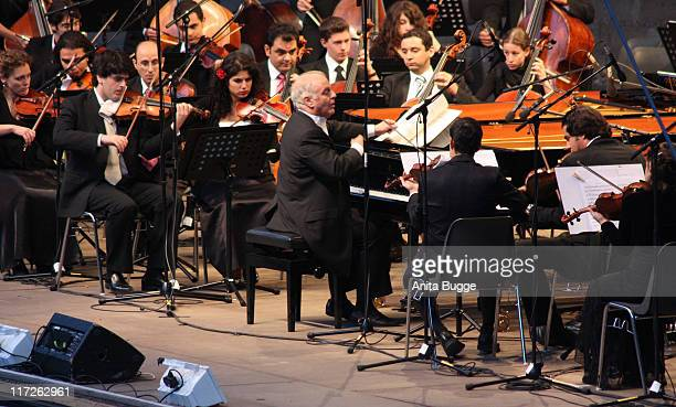 Conductor and pianist Daniel Barenboim and the West Divan Orchestra perform at the Waldbuehen Berlin on August 23 2008 in Berlin Germany