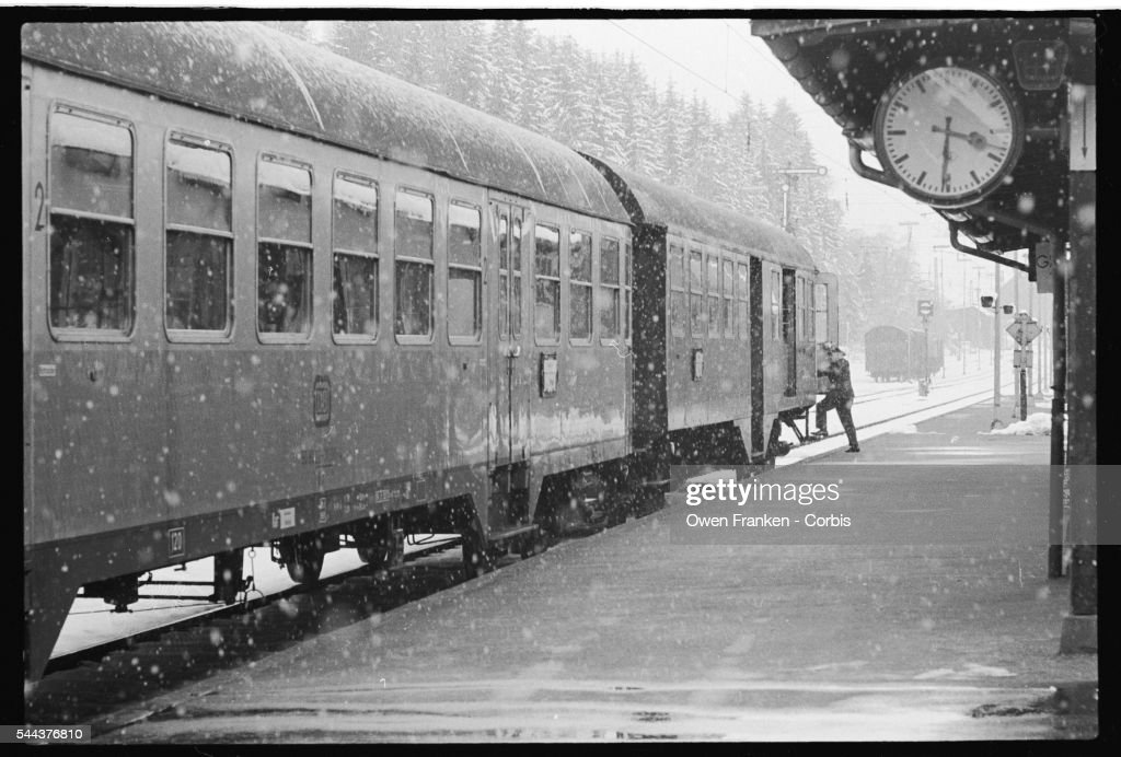 A conductor boards a train at the Titisee station during a heavy snowfall | Location Titisee West Germany
