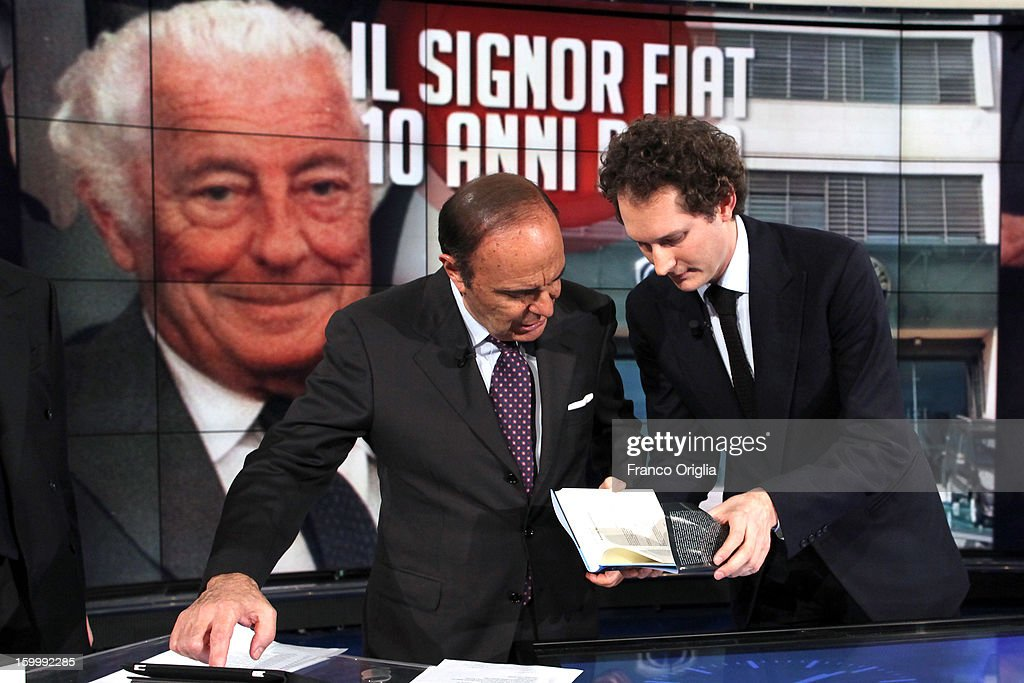 TV conductor Bruno Vespa (L) and Fiat Chairman John Elkann (R) attend 'Porta A Porta' Italian TV Show on January 24, 2013 in Rome, Italy. Today President of Italian Republic Giorgio Napolitano remembered after 10 years the death of Gianni Agnelli - President and principal shareholder of Fiat Group at the Cathedral of Torino.
