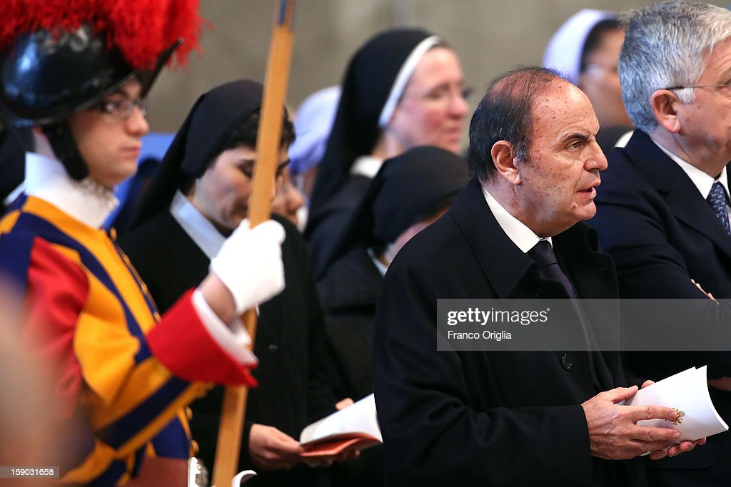 TV conductor Bruno Vespa (R) attends the Epiphany Mass at the St. Peter's Basilica held by Pope Benedict XVI on January 6, 2013 in Vatican City, Vatican. During the ceremony the pontiff named four new bishops including his personal secretary Georg Gaenswein.