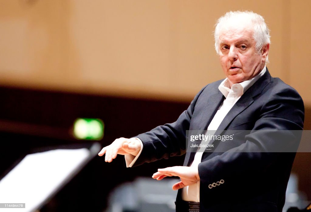 Conductor <a gi-track='captionPersonalityLinkClicked' href=/galleries/search?phrase=Daniel+Barenboim&family=editorial&specificpeople=242823 ng-click='$event.stopPropagation()'>Daniel Barenboim</a> conducts the West-Eastern Divan Orchestra during the concert rehearsal at the Berlin Philharmonic on May 22, 2011 in Berlin, Germany. <a gi-track='captionPersonalityLinkClicked' href=/galleries/search?phrase=Daniel+Barenboim&family=editorial&specificpeople=242823 ng-click='$event.stopPropagation()'>Daniel Barenboim</a> and the West-Eastern Divan Orchestra will be playing the Waldbuehne in Berlin, in Cologne and will be doing a worldwide tour in 2011.