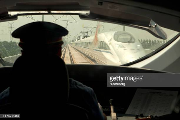 A conductor drives a BeijingShanghai high speed train during a media tour in transit between Beijing and Shanghai China on Monday June 27 2011...