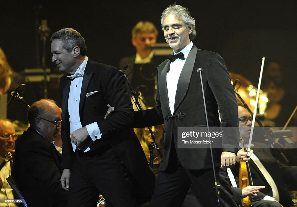 Conductor Eugene Kohn (L) and <a gi-track='captionPersonalityLinkClicked' href=/galleries/search?phrase=Andrea+Bocelli&family=editorial&specificpeople=211558 ng-click='$event.stopPropagation()'>Andrea Bocelli</a> perform in support of Andrea's Opera release at HP Pavilion on November 23, 2012 in San Jose, California.