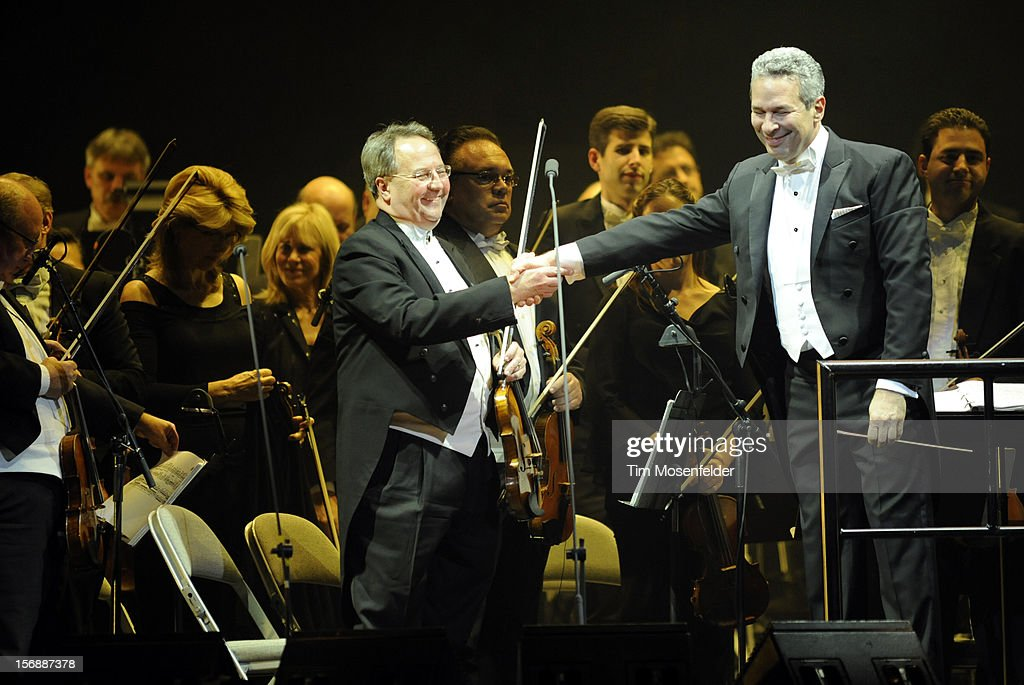 Conductor Eugene Kohn (R) performs in support of Andrea Bocelli's Opera release at HP Pavilion on November 23, 2012 in San Jose, California.