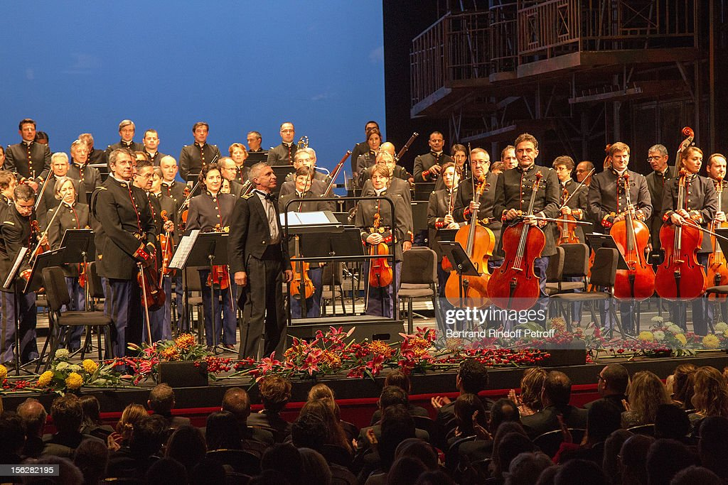 Conductor Francois Boulanger (2nd left in foreground on stage) acknowledges applause prior to conducting the French Republican guard symphonic orchestra during the Gala de l'Espoir charity event against cancer at Theatre du Chatelet on November 12, 2012 in Paris, France.