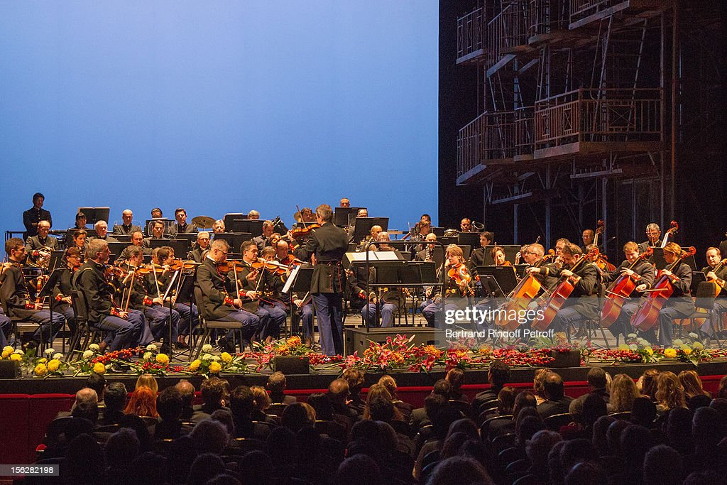 Conductor Francois Boulanger, standing on stage at center, conducts the French Republican guard symphonic orchestra during the Gala de l'Espoir charity event against cancer at Theatre du Chatelet on November 12, 2012 in Paris, France.