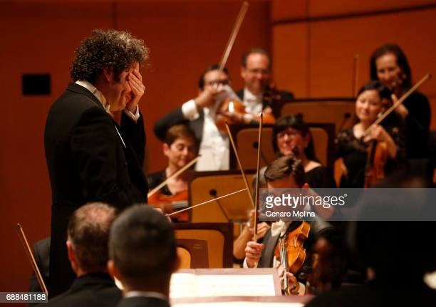SEQUENCE Conductor Gustavo Dudamel composes himself after a lone concertgoer's hoot at the end of the first movement of Schubert's Symphony No 4...