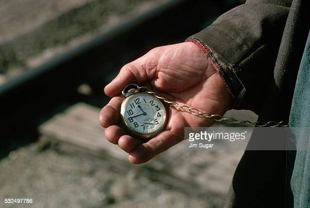 Conductor Holding Pocket Watch