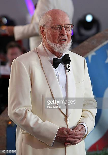 Conductor John Williams debuts his new version of the 'The StarSpangled Banner' at PBS's 2014 A CAPITOL FOURTH at US Capitol West Lawn on July 4 2014...