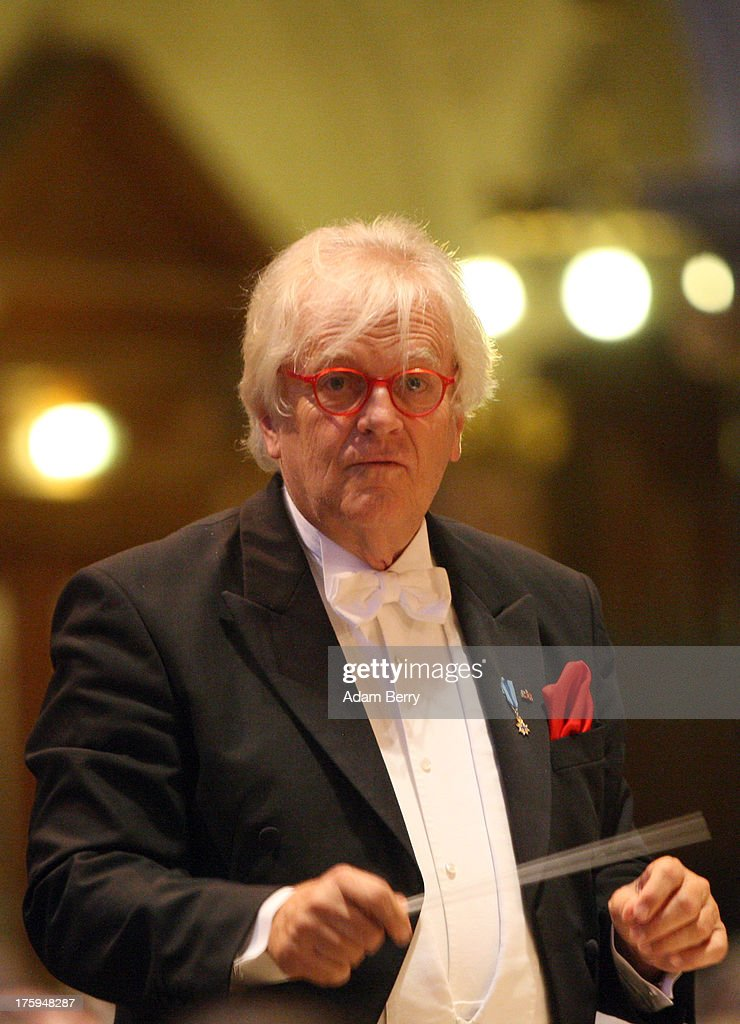 Conductor <a gi-track='captionPersonalityLinkClicked' href=/galleries/search?phrase=Justus+Frantz&family=editorial&specificpeople=226661 ng-click='$event.stopPropagation()'>Justus Frantz</a> leads the Philharmonie der Nationen orchestra on its 'Sommersinfonie' tour in the Berliner Dom (Berlin Cathedral) on August 10, 2013 in Berlin, Germany. The orchestra was founded in 1995 and features musicians from forty countries, predominently Eastern European countries. In the Berliner Dom, they performed Mozart's Violin Concerto Nr. 3 in G Major and Bruckner's Symphony No. 3 in D Minor.