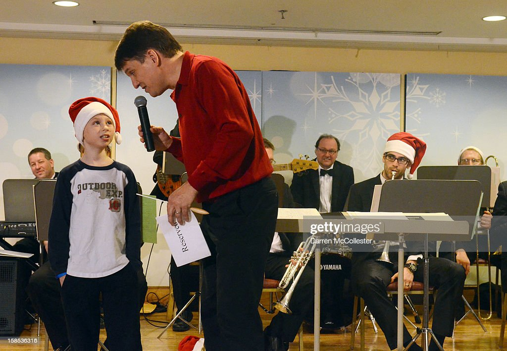 Conductor <a gi-track='captionPersonalityLinkClicked' href=/galleries/search?phrase=Keith+Lockhart+-+Orchestral+Conductor&family=editorial&specificpeople=4508918 ng-click='$event.stopPropagation()'>Keith Lockhart</a> performs at the Boston Pops Holiday Concert with Bradley at Boston Children's Hospital on December 18, 2012 in Boston, Massachusetts.